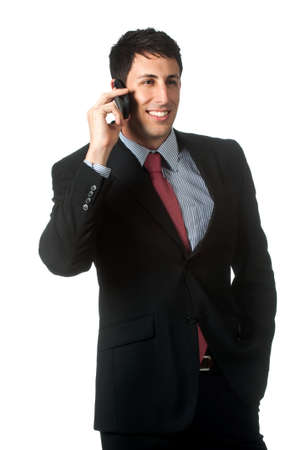 An attractive businessman talking on the phone against white background Stock Photo - 6309579