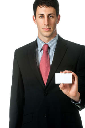 A good looking businessman holding up his namecard, against white background photo