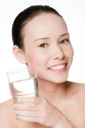 beauty portrait of a young and attractive woman isolated on white background with a glass of water Stock Photo - 6338194