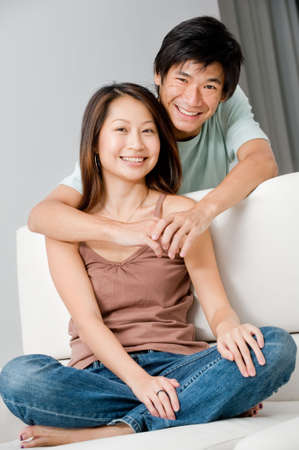 A good looking couple relaxing on their couch at home Stock Photo - 6519175
