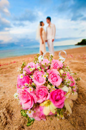 getting married: An attractive bride and groom getting married by the beach