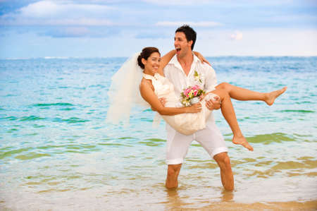 An attractive bride and groom getting married by the beach Stock Photo - 6593251