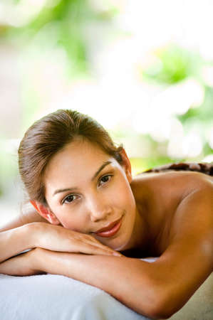 An attractive young woman lying on a massage bed at a spa outdoors Stock Photo - 6672087