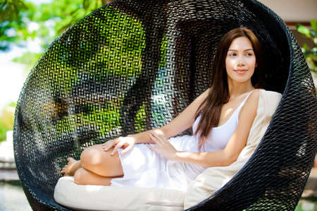An attractive caucasian woman relaxing and lounging outdoors photo