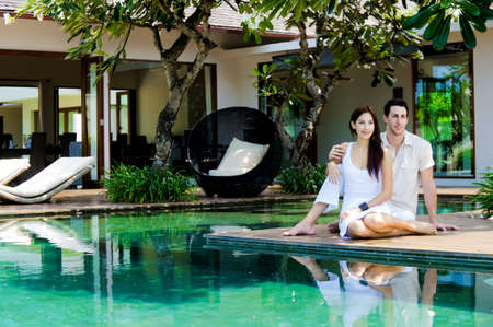 An attractive caucasian couple relaxing and lounging outdoors photo
