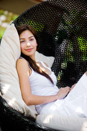 lounging: An attractive caucasian woman relaxing and lounging outdoors
