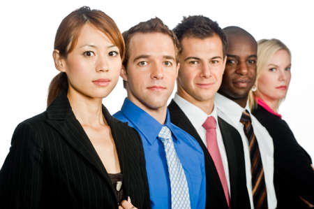 A group of young, attractive and diverse business professionals in formal wear standing together on white background photo
