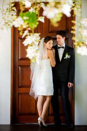 An attractive caucasian couple getting married outdoors Standard-Bild