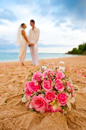 An attractive caucasian couple getting married by the beach