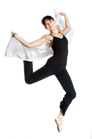 A young asian ballerina dances with a scarf against white background photo