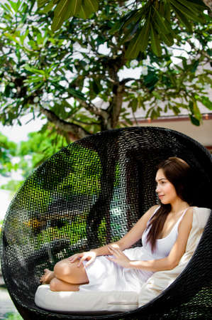 An attractive young woman relaxing and lounging outdoors photo