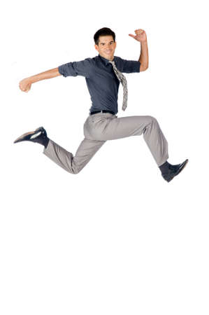 An attractive athletic businessman jumping up against white background Stock Photo