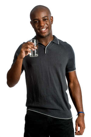 An attractive man drinking a glass of water against white background Stock Photo - 7048123