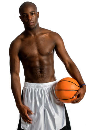 An attractive athletic man holding a basketball against white background Stock Photo