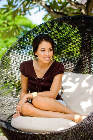 An attractive young woman relaxing and lounging outdoors Stock Photo - 7221358