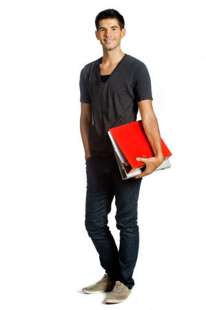good looking man: A good looking man holding some files and standing against white background Stock Photo