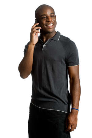 An attractive man talking on his mobile phone against white background photo