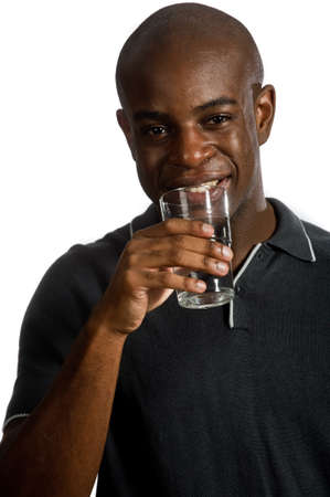 An attractive man drinking a glass of water against white background Stock Photo - 7323174