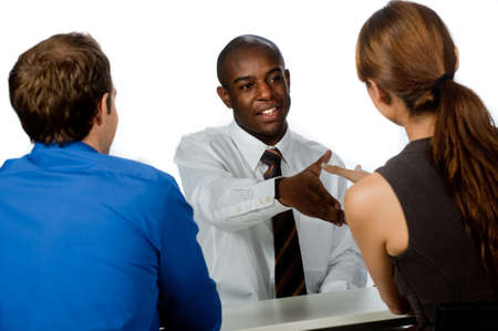 A young and professional businessman shaking hands and securing a deal in his office photo