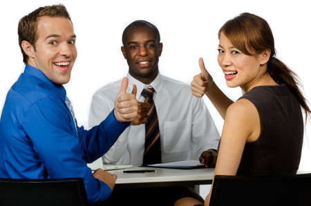 good looking woman: An attractive young group of business professionals giving the thumbs up in their office against white background