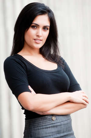 An attractive Indian businesswoman standing outside