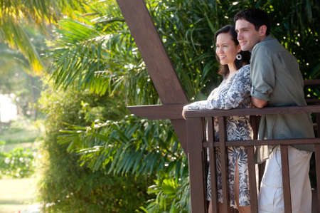A young couple on vacation standing on the balcony photo