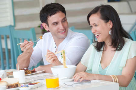 A young couple on vacation having breakfast photo
