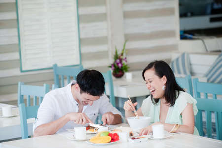 A young couple on vacation having breakfast Stock Photo - 9404641
