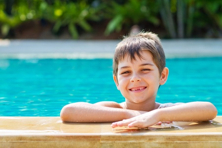 Happy young smiling boy in the pool Standard-Bild