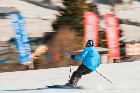 amateur skier cornering during a descent Stock Photo