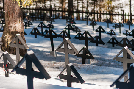 Crosses in a military cemetery of the first World War in Italy. Winter season, snow on the ground