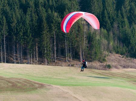 paraglider landing on the ground