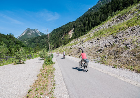 Bicycle lane between Italy (Innichen- San Candido) and Austria (Lienz). Bicycles go through nature without car.