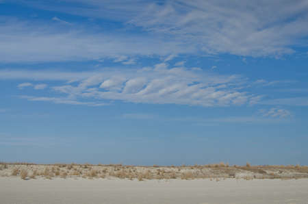 Blue sky, white clouds and sand