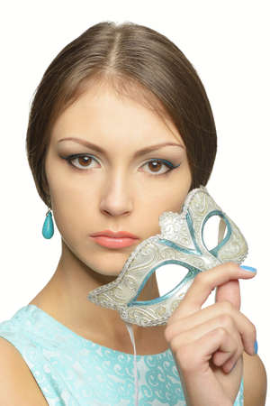 brown  eyed: The girl holds in her hands a carnival mask from Venice. Young brunette with brown eyes. Make-up and manicure azure