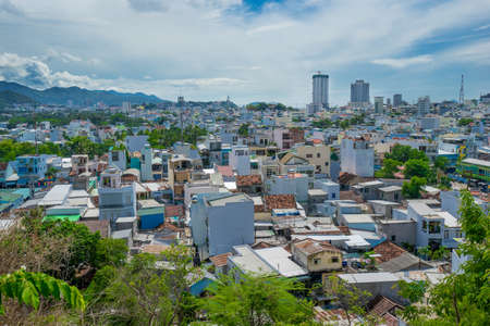 birdseye: NHA TRANG, VIETNAM - JUNE 21, 2016: Birds-eye view to houses and buildings of the city in Vietnam at hot sunny day with cloudy sky