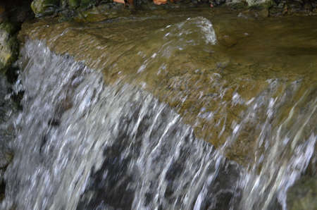 fluent: Edge of a small waterfall