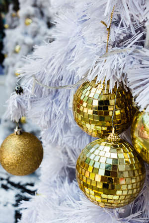 Beautiful decorated christmas tree with gold bauble