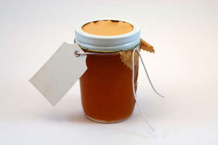 A jar of fresh homemade pear preserves. Stock Photo