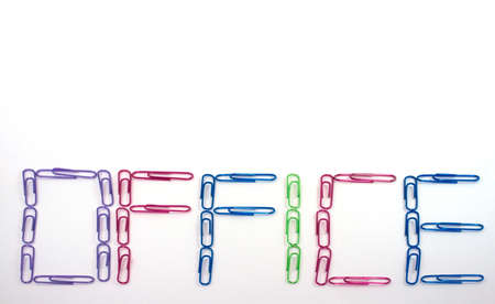 A group of colored paperclips forming the word