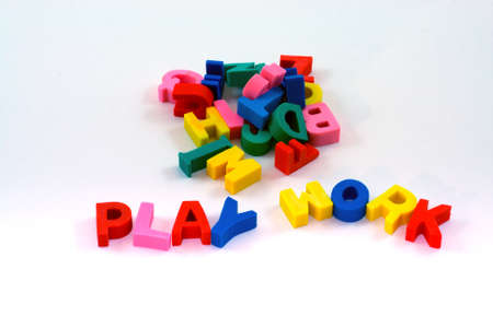 Brightly colored erasers that fall out of a pile to form the words  Stock Photo