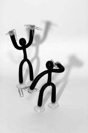 Magnetic paperclips holder figures depicting a holdup on a white background.