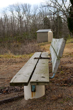 The bench where parents watch their children swim sits empty, waiting for summer to arrive again. Stock Photo