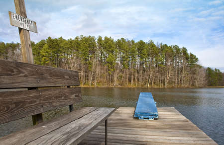 A lonely diving board sits at the end of the swimming dock at a southern Indiana lake in mid-November.
