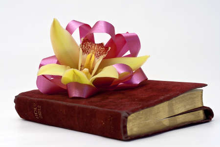 A traditional Easter corsage on a closed well worn Bible  Stock Photo