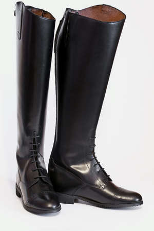 A new pair of lace front tall field boots used in hunt seat style riding competition