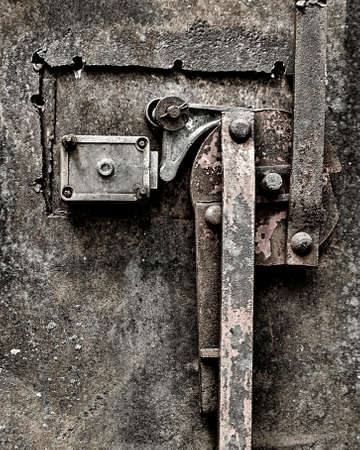 A grungy, rusty, old door locking mechanism. Stock Photo