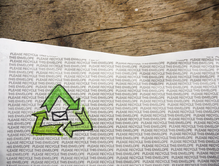 Paper with Recycling Symbol and Text Please Recycle this Envelope Stock Photo