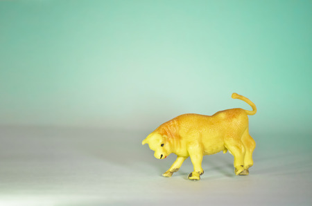 Toy Bull Figurine Isolated on Green Background Stock Photo