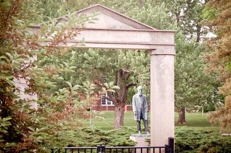 Kirksville, Missouri / USA - May 27 2018: Archway and Joseph Baldwin Statue on Truman State University Campus